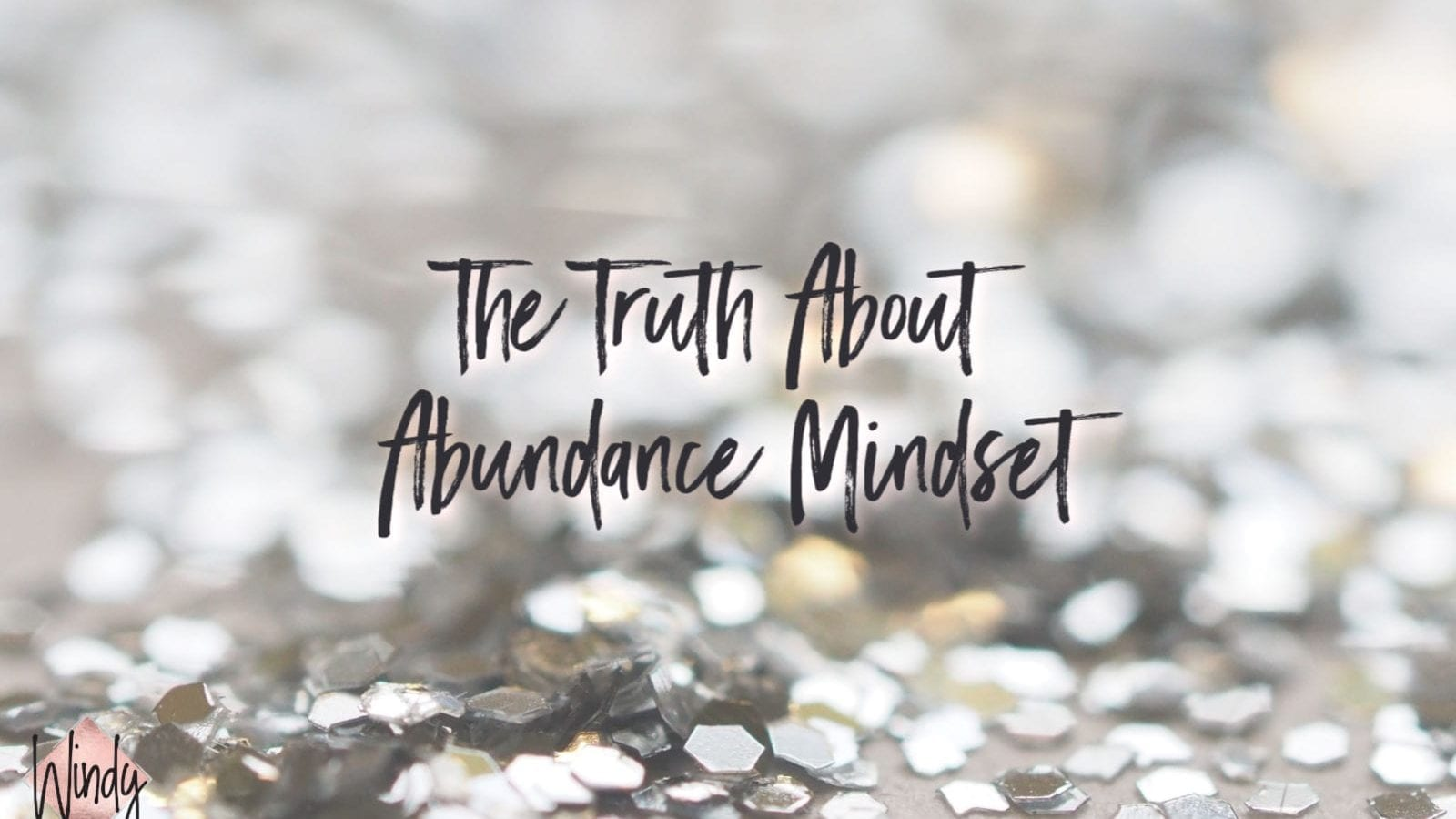 Glitter with the words The Truth About Abundance Mindset