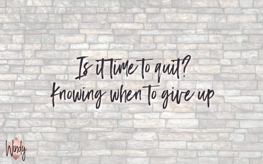 Brick wall with the words Is it time to quit, knowing when to give up